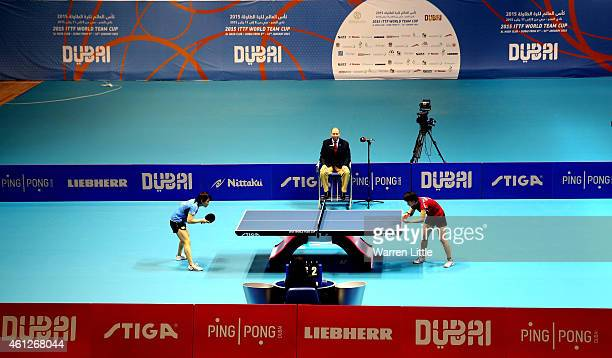 Sayaka Hirano of Japan and Mi Gyong Ri of North Korea battle it out during the semi finals of the 2015 IFFT World Team Cup at the Al Nasr Stadium on...