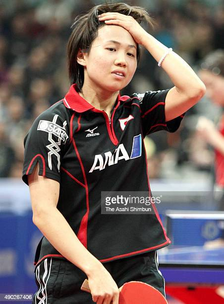 Sayaka Hirano of Japan reacts during her match against Li Jiawei of Singapore in the Women's Team semifinal during the 2008 World Team Table Tennis...