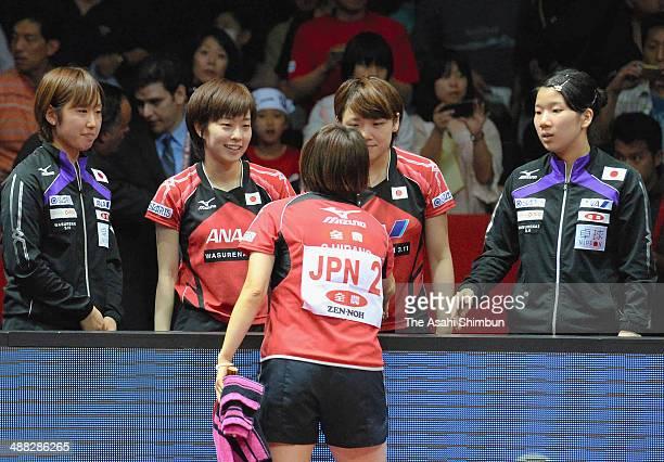 Sayaka Hirano of Japan shakes hands with her teammates Saki Tashiro Kasui Ishikawa Yuka Ishigaki and Sakura Mori after winning the silver medals...