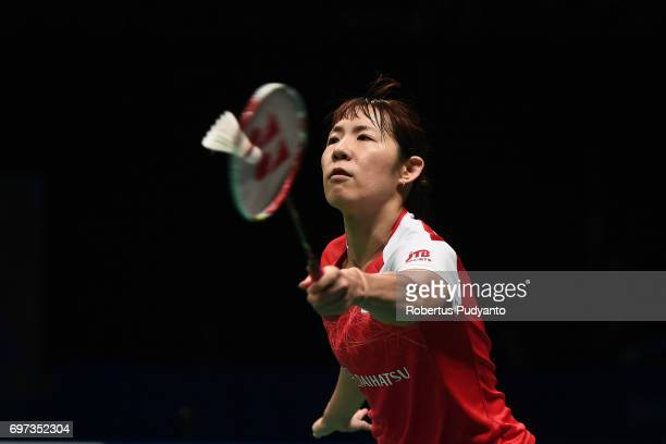 Sayaka Sato of Japan competes against Sung Ji Hyun of Korea during Women's Single Final match of the BCA Indonesia Open 2017 at Plenary Hall Jakarta...