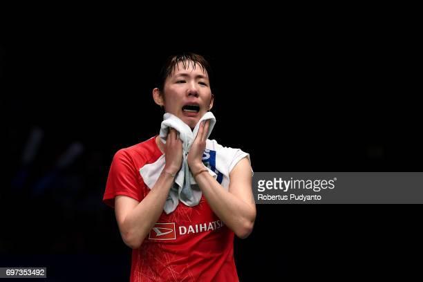 Sayaka Sato of Japan cries after beating Sung Ji Hyun of Korea during Women's Single Final match of the BCA Indonesia Open 2017 at Plenary Hall...
