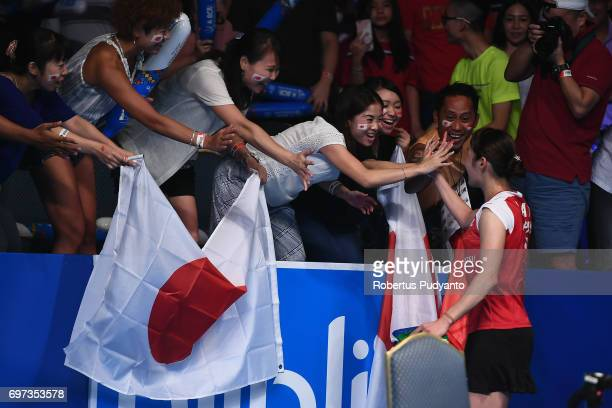Sayaka Sato of Japan greets the Japanese fans after beating Sung Ji Hyun of Korea during Women's Single Final match of the BCA Indonesia Open 2017 at...