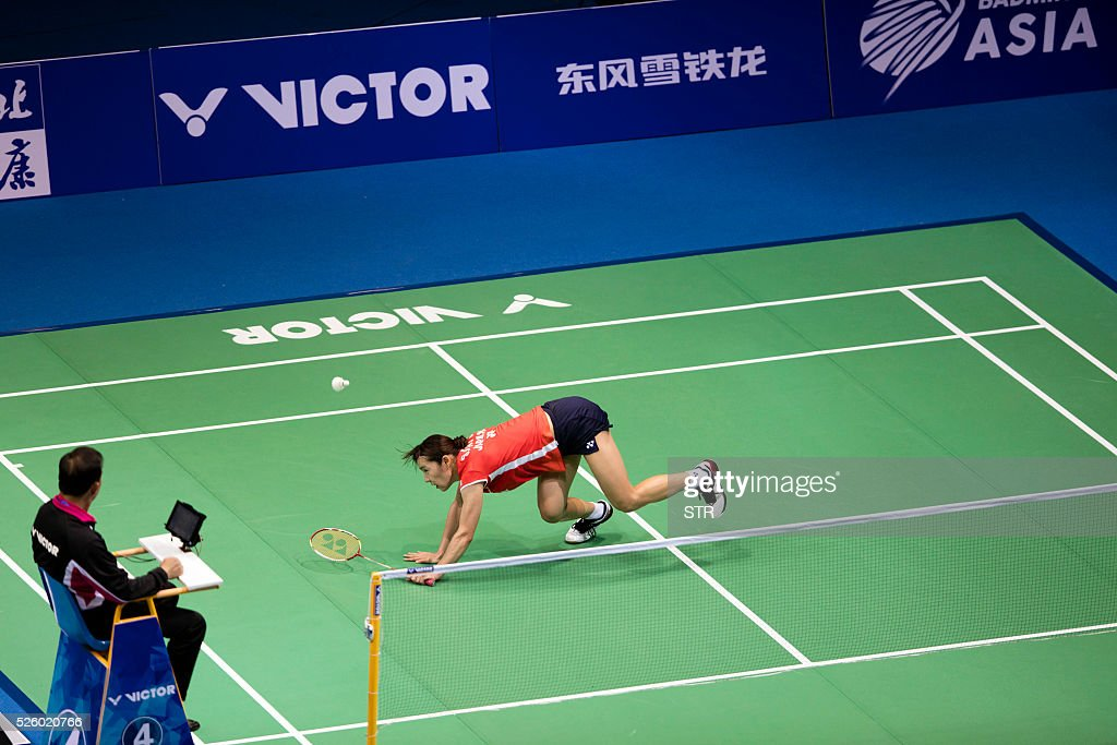 Sayaka Sato of Japan hits a return against Sung Ji Hyun of South Korea during their women's singles quarter-final match at the 2016 Badminton Asia Championships in Wuhan, central China's Hubei province on April 29, 2016. / AFP / STR