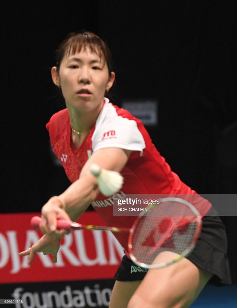 Sayaka Sato of Japan returns a shot against patriot Akane