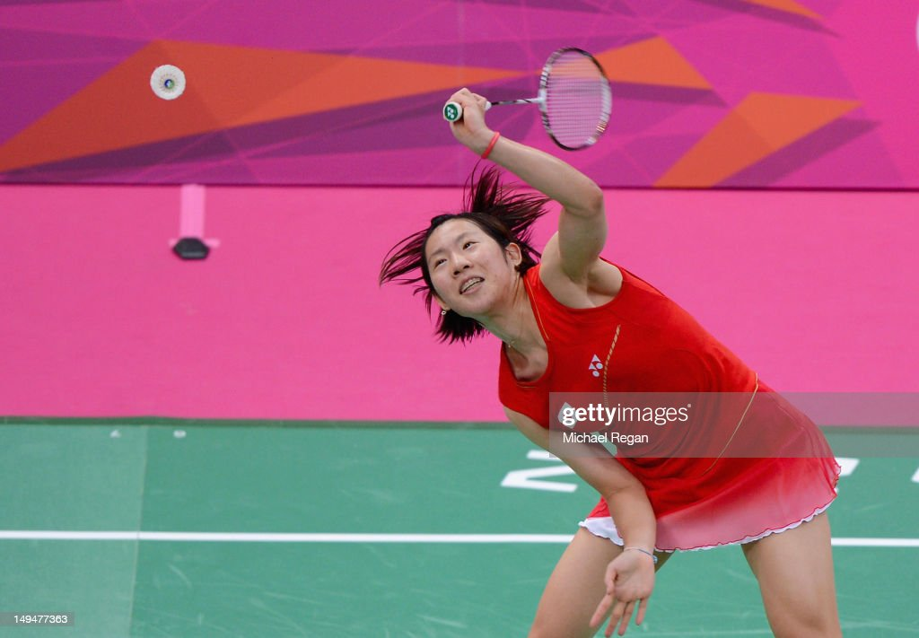 <a gi-track='captionPersonalityLinkClicked' href=/galleries/search?phrase=Sayaka+Sato&family=editorial&specificpeople=5848821 ng-click='$event.stopPropagation()'>Sayaka Sato</a> of Japan returns a shot against Maja Tvrdy of Slovenia during their Women's Singles Badminton on Day 2 of the London 2012 Olympic Games at Wembley Arena on July 29, 2012 in London, England.