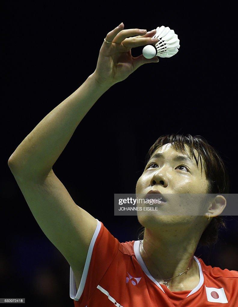 Sayaka Sato of Japan serves against Gadde Ruthvika Shivani of