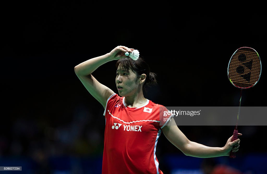 Sayaka Sato of Japan serves against Sung Ji Hyun of South Korea during their women's singles quarter-final match at the 2016 Badminton Asia Championships in Wuhan, central China's Hubei province on April 29, 2016. / AFP / STR
