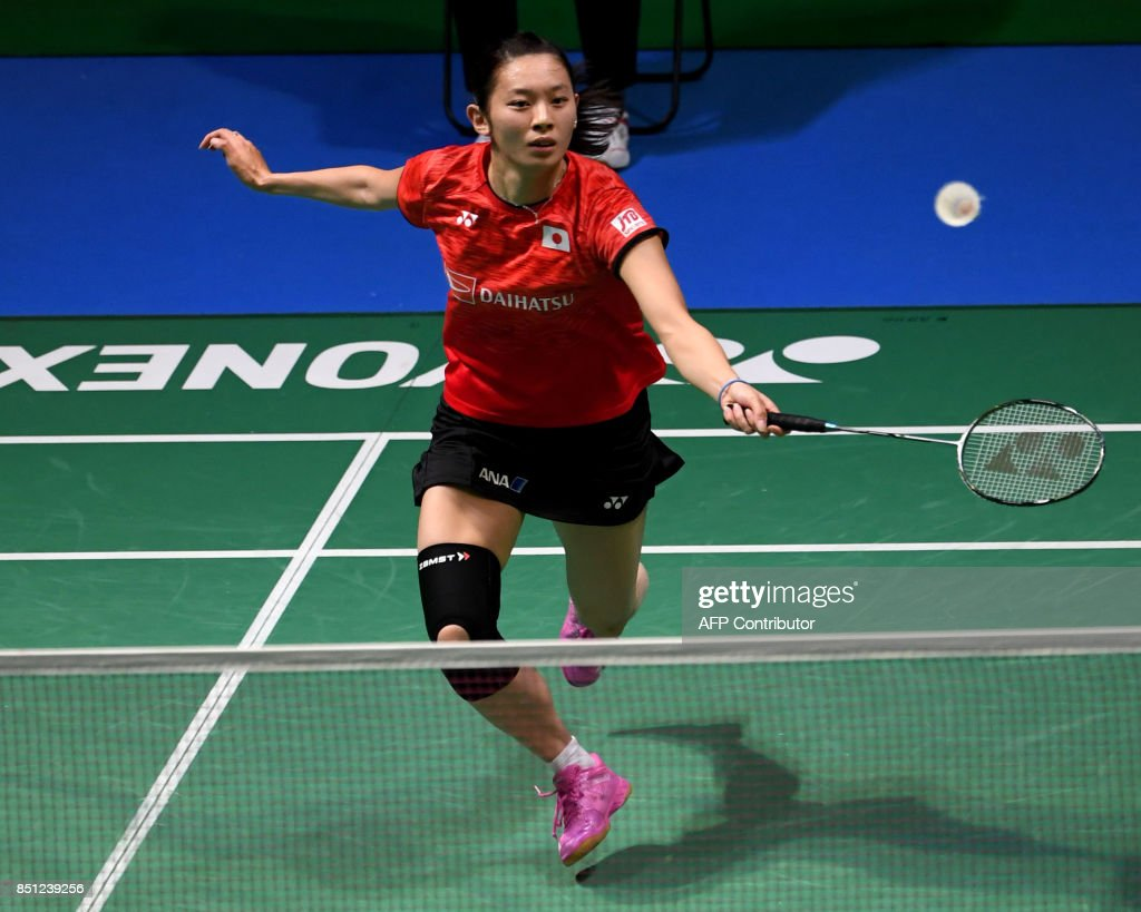Sayaka Takahashi of Japan hits a return against He Bingjiao of
