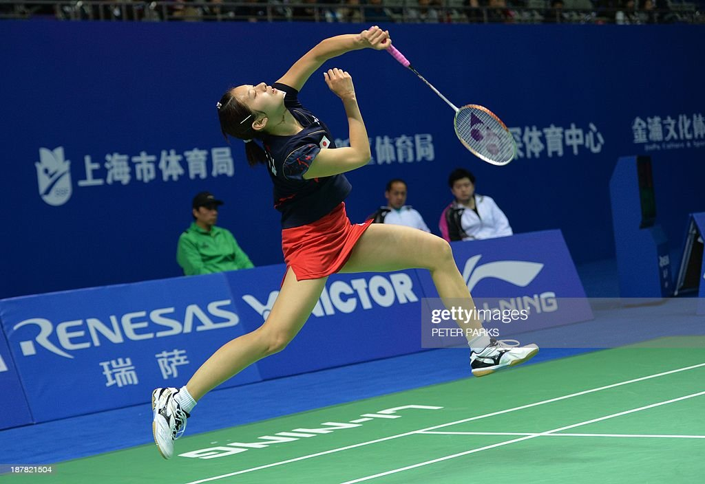 Sayaka Takahashi of Japan hits a return to Xuan Deng in the women's singles first round at the China Open badminton tournament in Shanghai on November 13, 2013. Takahashi won the match 21-13, 16-21, 22-20. AFP PHOTO/Peter PARKS