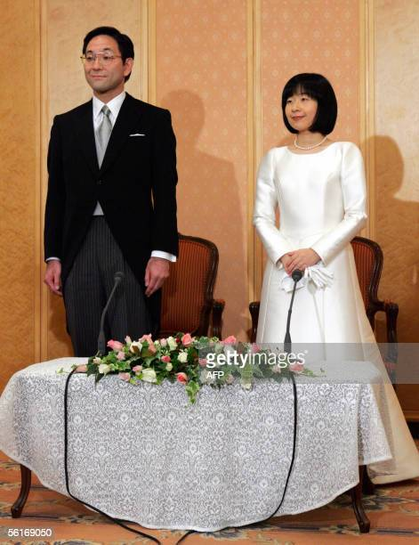 Sayako Kuroda and her husband Yoshiki Kuroda attend a press conference following their wedding ceremony at a Tokyo hotel 15 November 2005 Princess...