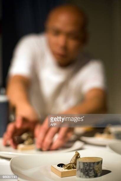 Sayan Isaksson of Sweden adds the finishing touches to his dish at the 'Seven Sushi Samurai' Sushi of the Year awards 2009 at the Olympia exhibition...