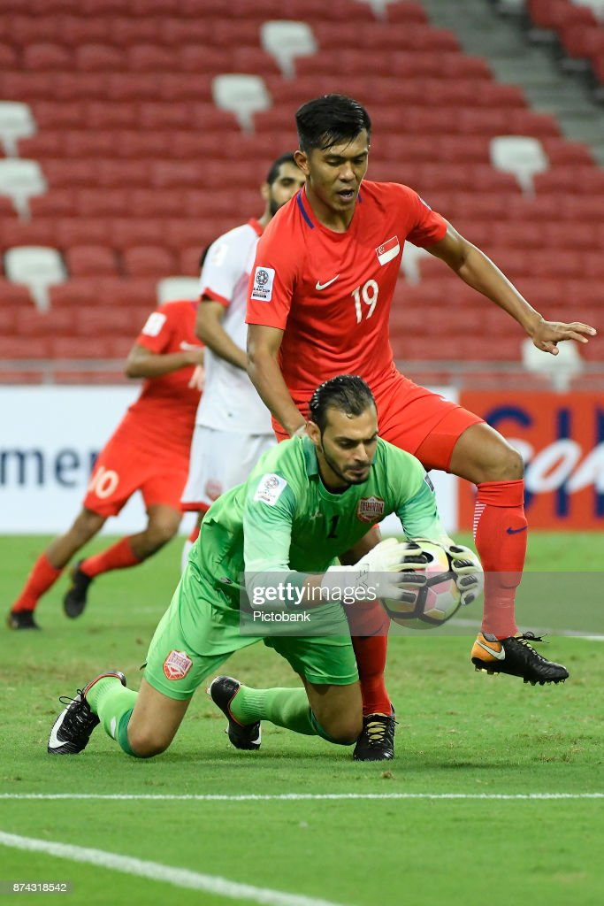 Sayed Shubbar of Bahrain is challenged by Khairul Amri of Singapore during the Asian Cup Qualifier match between Singapore and Bahrain at the Singapore Sports Hub on November 14, 2017, in Singapore, Singapore.