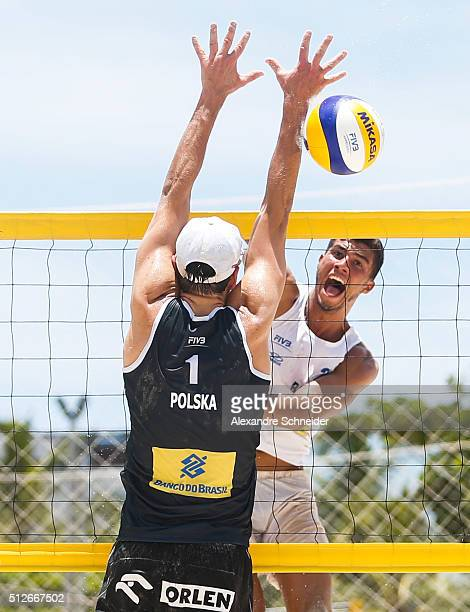 Saymon Barbosa of Brazil spikes the ball against Poland during the quarters final match against Poland at Pajucara beach during day five of the FIVB...