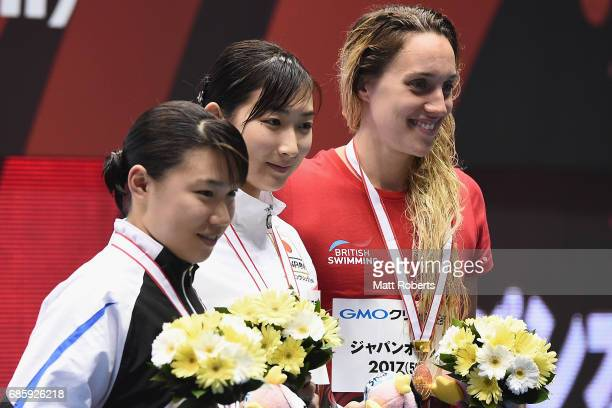 Sayuki Ouchi of Japan Rikako Ikee of Japan and Alys Thomas of Great Britain pose with their medals on the podium after the 50m Butterfly Final during...