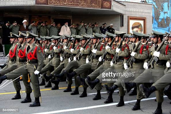 Sayyid Ali Khamenei - Politician, Spiritual Leader of the Islamic Republic of Iran, Commander of the iranian armed forces (bright cloak), during a military parade in Tehran
