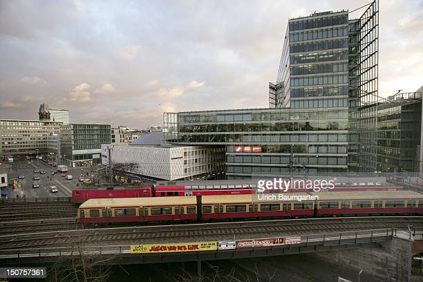 Bahn and regional train of the Deutsche Bahn AG passing the centre of Berlin