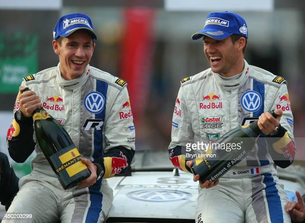 Sébastien Ogier and Julien Ingrassia of France and Volkswagen Motorsport celebrate after winning the FIA World Rally Championship after the Great...
