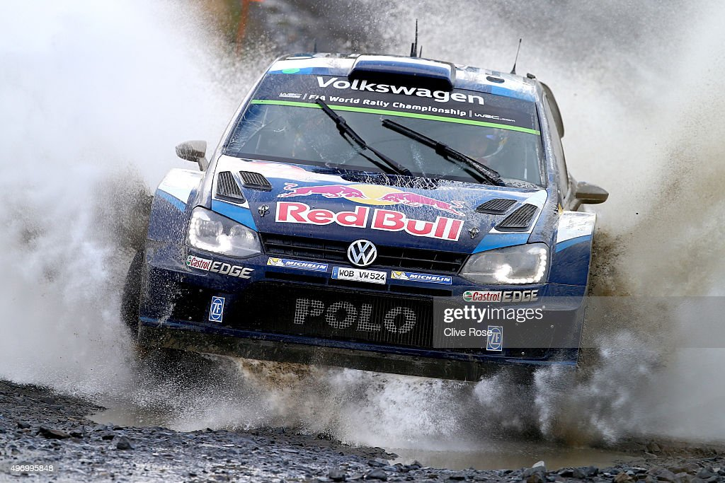 Sébastien Ogier and <a gi-track='captionPersonalityLinkClicked' href=/galleries/search?phrase=Julien+Ingrassia&family=editorial&specificpeople=4947850 ng-click='$event.stopPropagation()'>Julien Ingrassia</a> of France drive the Volkswagen Motosport Polo R WRC during during the Sweet Lamb stage of the FIA World Rally Championship Great Britain on November 13, 2015 in Pont Rhydgaled, Wales.