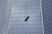 A scaffold carrying two workers hangs 69 floors up at 1 World Trade Center on November 12 2014 in New York City The workers were washing windows 69...