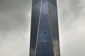 A scaffold carrying two workers hangs 69 floors up at One World Trade Center on November 12 2014 in New York City The workers were washing windows 69...