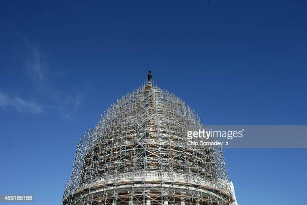 Scaffolding completely surrounds the US Capitol dome during the ongoing restoration project November 18 2014 in Washington DC Workers will now being...