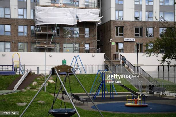 Scaffolding covers an area of removed cladding on the Burnham Tower in the Chalcot estate on August 3 2017 in London England Despite ongoing concerns...
