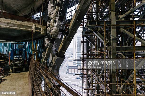 Scaffolding covers structures inside Morpheus Melco Crown Entertainment Ltd's new hotel tower under construction at the company's City of Dreams...