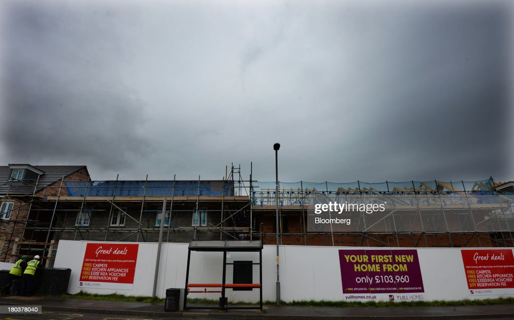 Scaffolding stands outside residential housing during development on a Yuill Homes construction site, operated by Cecil M. Yuill Ltd., in Newcastle-upon-Tyne, U.K., on Wednesday, Sept. 11, 2013. U.K. house prices rose for a seventh month in August and will probably continue to increase through the rest of the year, according to a report by Halifax. Photographer: Nigel Roddis/Bloomberg via Getty Images