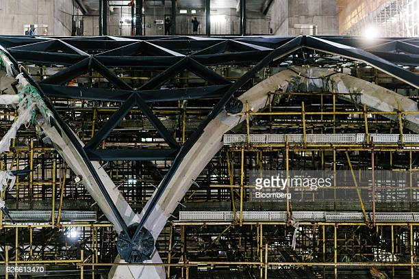Scaffolding supports an internal structure inside Morpheus Melco Crown Entertainment Ltd's new hotel tower under construction at the company's City...