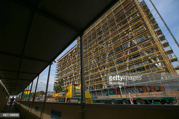 Scaffolding surrounds the 50Hertz Transmission GmbH headquarter as it is built on the construction site of Europacity a new commercial district in...