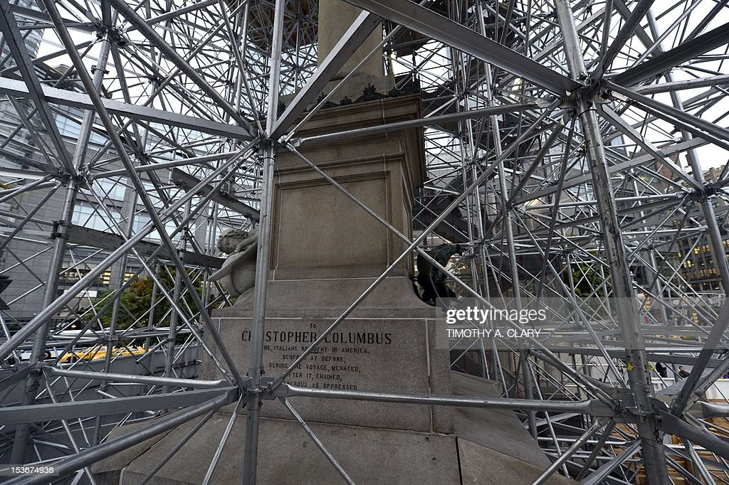 Scaffolding surrounds the base of the colossal 13-foot-tall statue of Christopher Columbus at Columbus Circle in New York on October 8, 2012 where Japanese artist Tatsu Nishi's installation around the statue standing in a fully furnished, modern living room featuring tables, chairs, couch, rug, and flat-screen television, reflecting the artist's interpretation of contemporary New York style. His installation around the weathered marble statue, designed by the Italian sculptor Gaetano Russo in 1892, rises to more than 75 feet atop a granite column. Visitors can enter the 'Discovering Columbus' apartment built around the statue elevated from the ground by scaffolding, located in the downtown Columbus Circle until November 18.