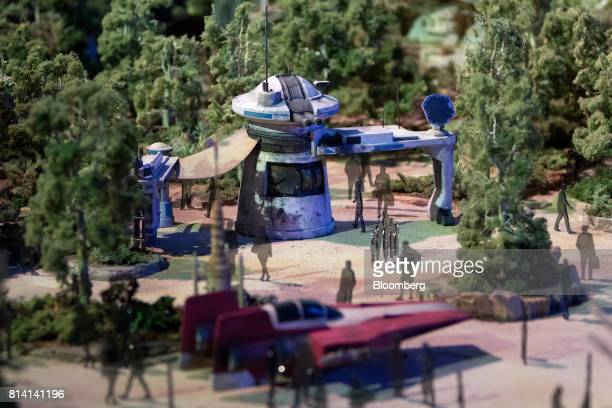 Scale figures stand inside the Walt Disney Co 'Star Wars' lands 3D model unveiled ahead of the D23 Expo in Anaheim California US on Thursday July 13...