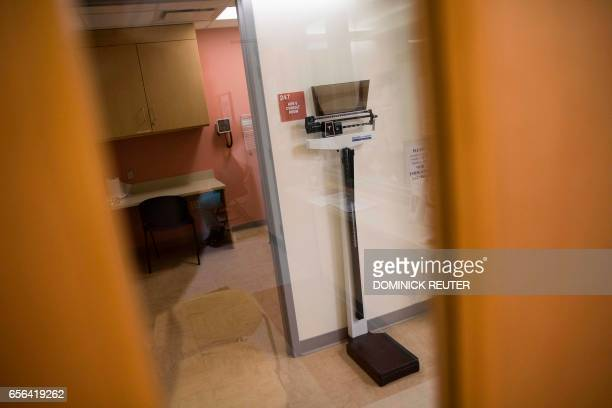 A scale is seen outside an examination room at the Esperanza Health Center in Philadelphia PA on March 13 2017 The center is located in North...