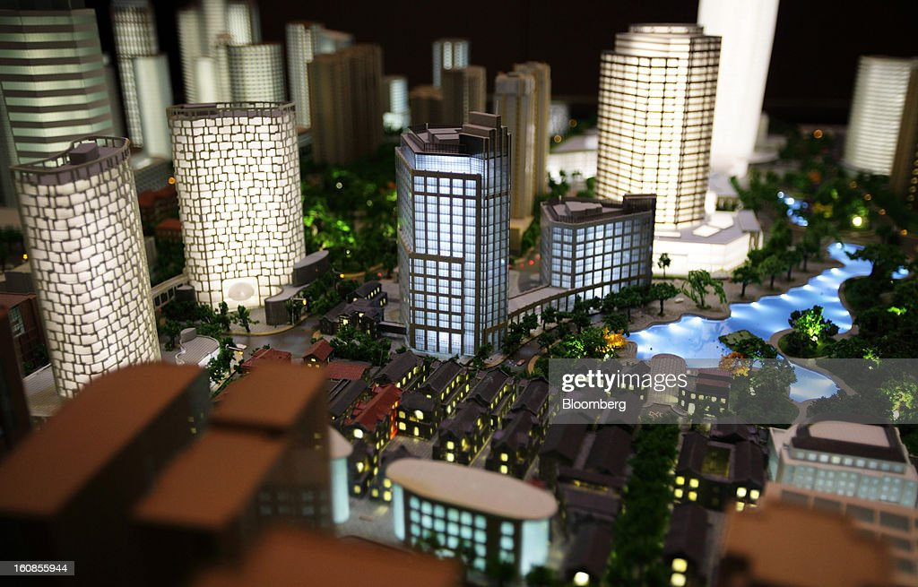 A scale model shows Shui On Land Ltd. commercial and residential developments at a showroom in Shanghai, China, on Wednesday, Feb. 6, 2013. China's economic growth accelerated for the first time in two years as government efforts to revive demand drove a rebound in industrial output, retail sales and the housing market. Photographer: Tomohiro Ohsumi/Bloomberg via Getty Images