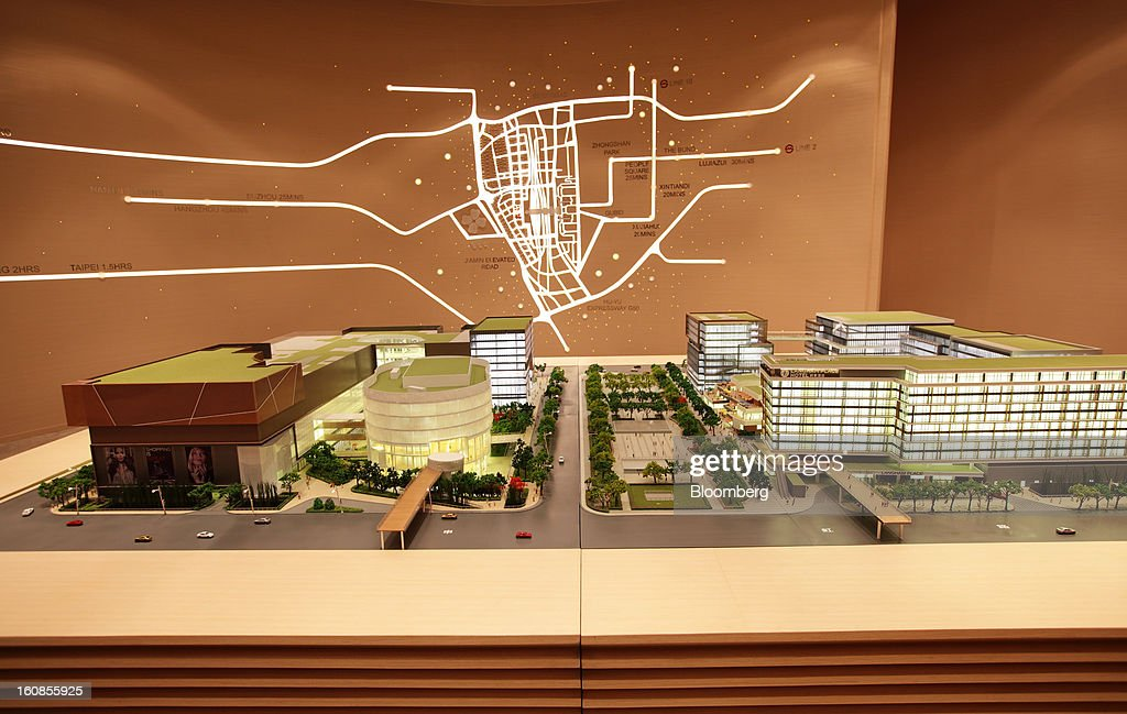 A scale model shows Shui On Land Ltd.'s The Hub project at the company's showroom near the Hongqiao transportation hub in Shanghai, China, on Wednesday, Feb. 6, 2013. China's economic growth accelerated for the first time in two years as government efforts to revive demand drove a rebound in industrial output, retail sales and the housing market. Photographer: Tomohiro Ohsumi/Bloomberg via Getty Images