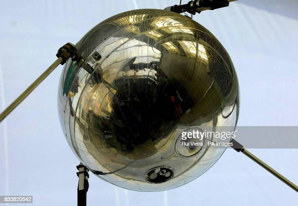 A scale version of the Sputnik satellite is seen at the National Space Centre Leicester