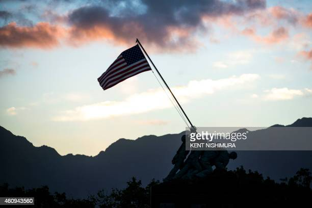 A scaled down replica of the Iwo Jima Memorial is seen at the main gate of Marine Corps Base Hawaii as US President Barak Obama's motorcade departs...