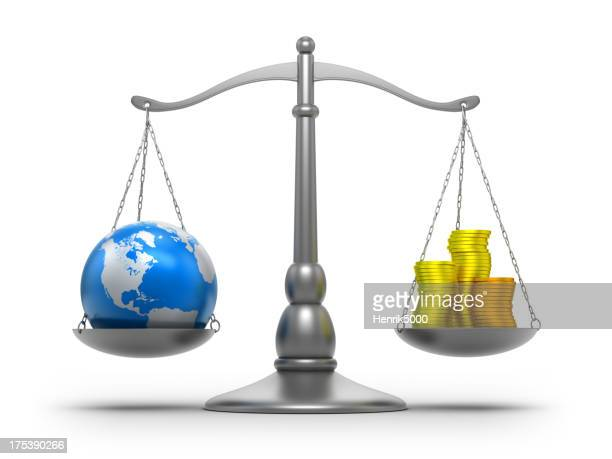Scales with earth and money - isolated / clipping path