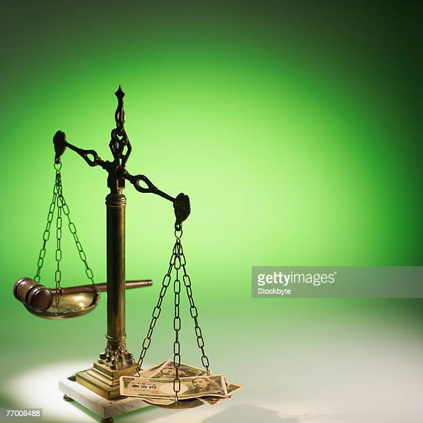 Scales with money and gavel in studio