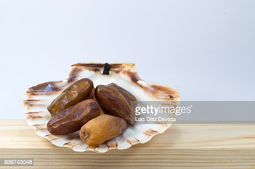 scallop shell filled with  dried dates