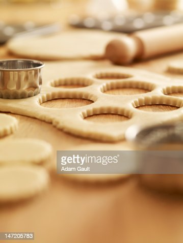 Scalloped cookie cutters and sugar cookie dough : Stock Photo
