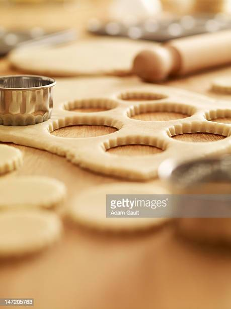 Scalloped cookie cutters and sugar cookie dough
