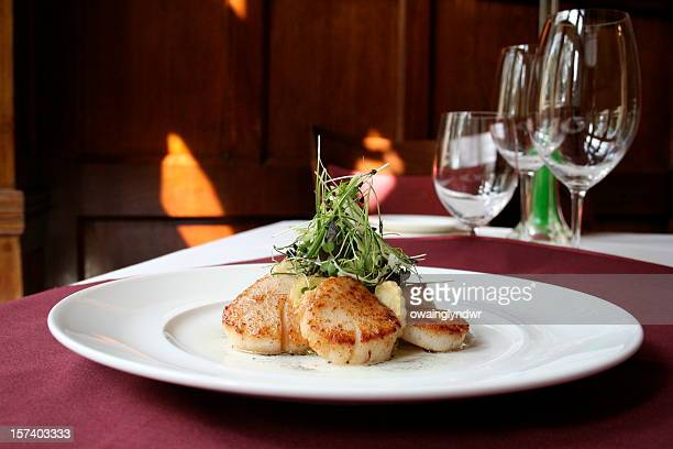 Scallops in a luxury dining table setting
