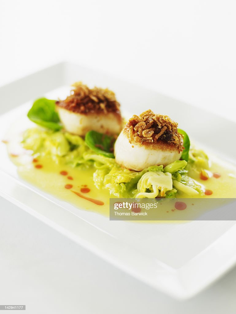 Scallops with brussels sprouts : Stock Photo