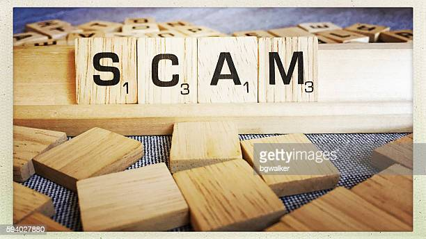 Scam Spelled with Scrabble Tiles Letters