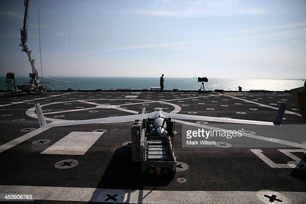 Scan Eagle drone sits on the deck of the USS Ponce on December 6 2013 in Manama Bahrain Secretary Hagel is on a sixday trip to the middle east before...