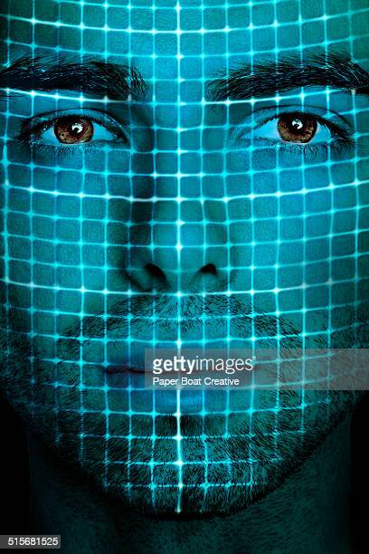 Scan of a man's face with grid laser beams