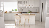 Scandinavian classic kitchen with wooden and white details, minimalistic interior designScandinavian classic kitchen with wooden and brown details, minimalistic interior design