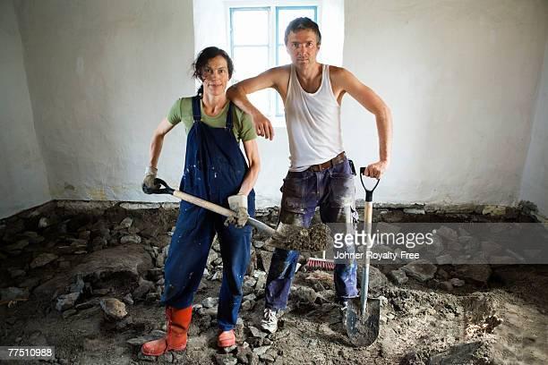Scandinavian couple renovating the floor in a room Oland Sweden.