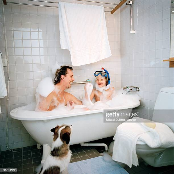 Scandinavian father and son taking a bath together Hammarby sjastad Sweden.